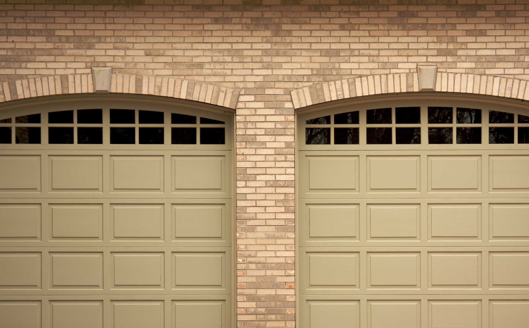 Replace Your Ugly Garage Door with help from the pros at Quality Door Service